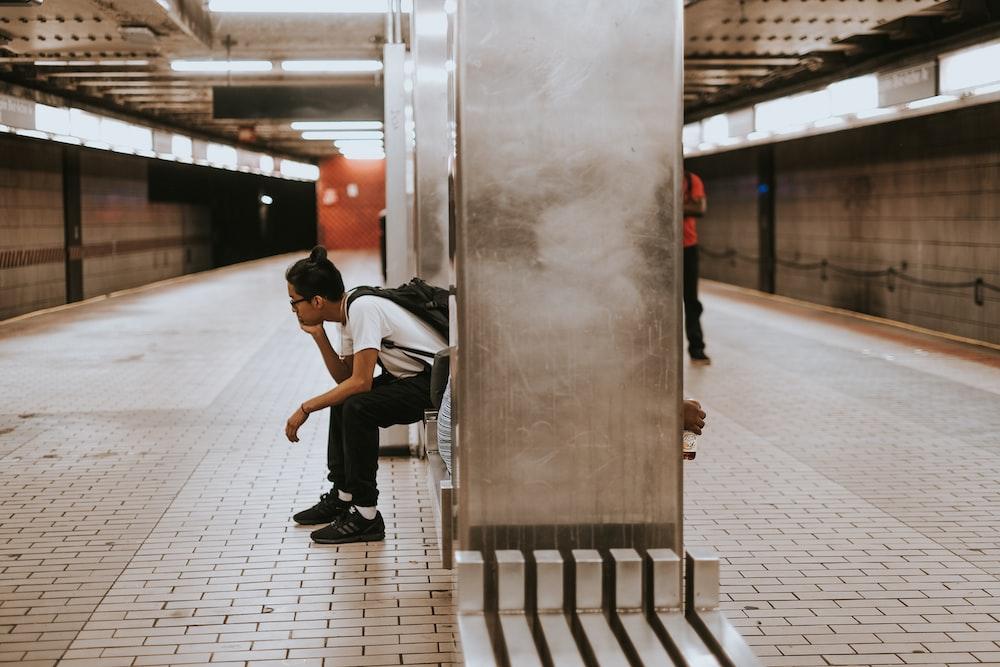 sitting man on metal chair