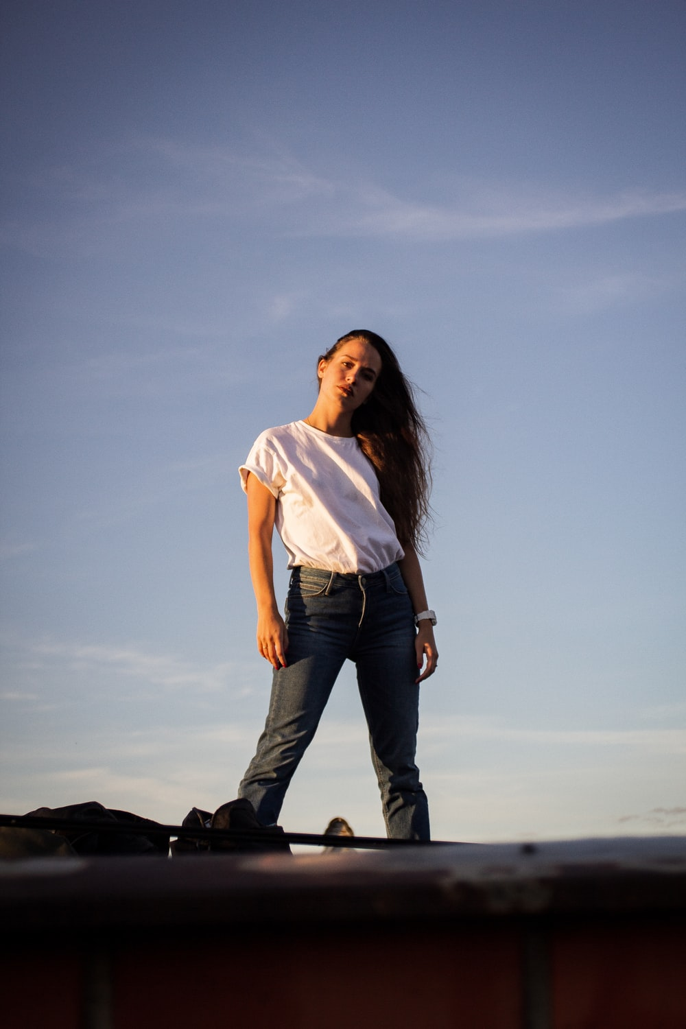 standing woman in white shirt