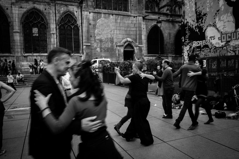 people dancing on street