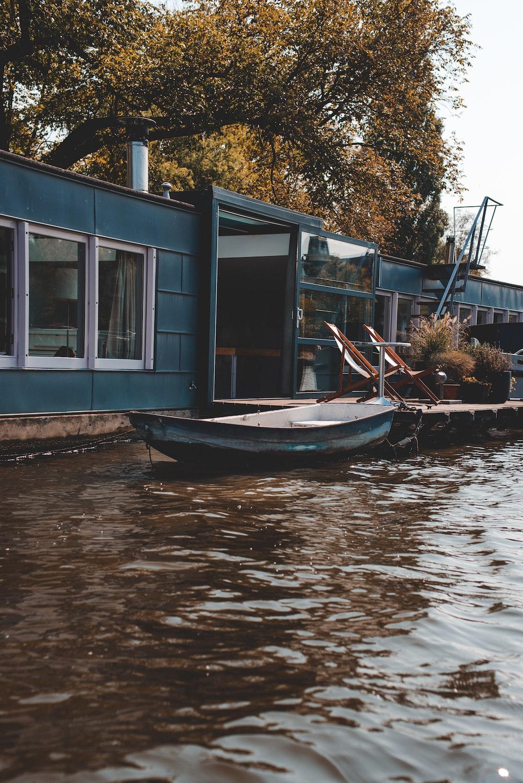 blue jon boat on body of water