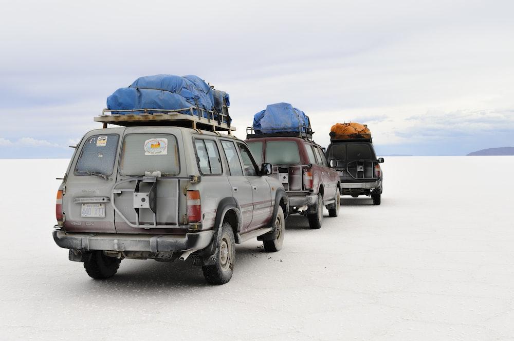 three vehicles during daytime