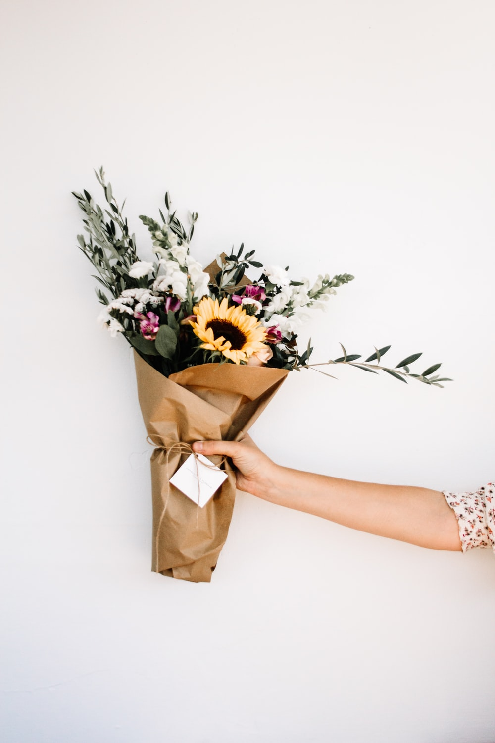 person holding bouquet of flowers