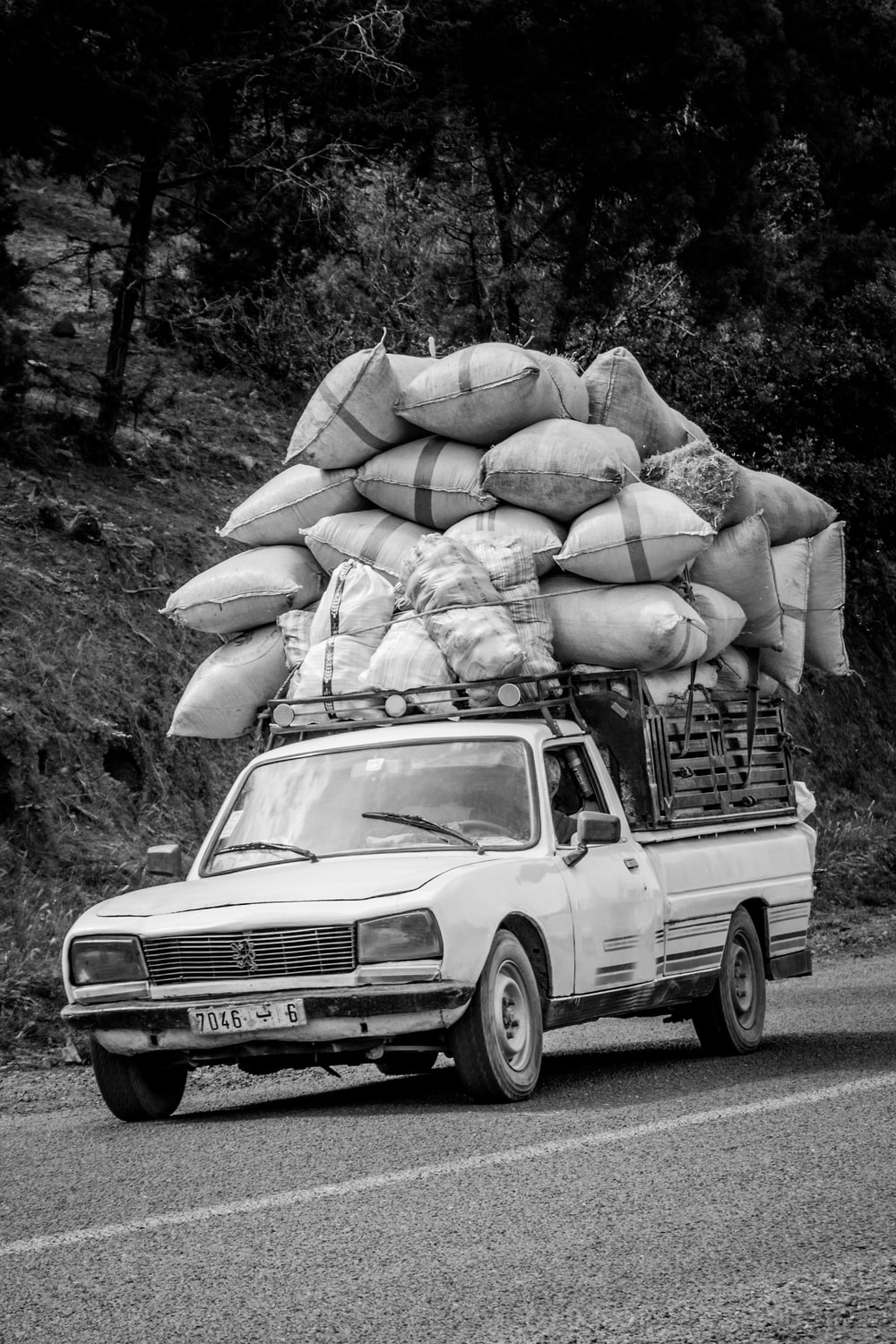 grayscale photography of pickup truck on road