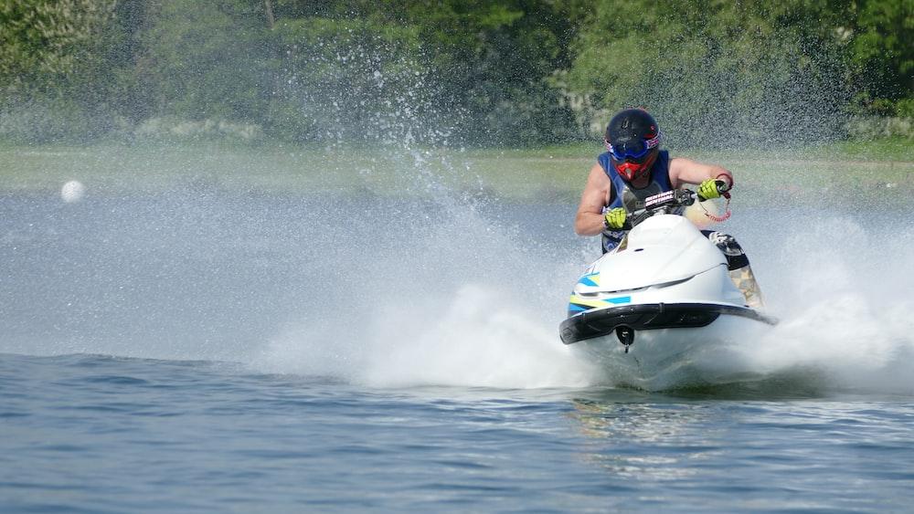 man riding personal watercraft at daytime