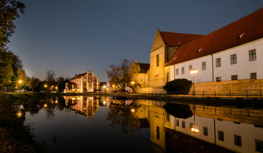 houses near lake during night time