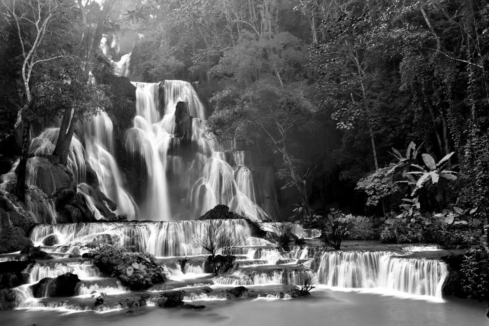 black and white photo of waterfalls