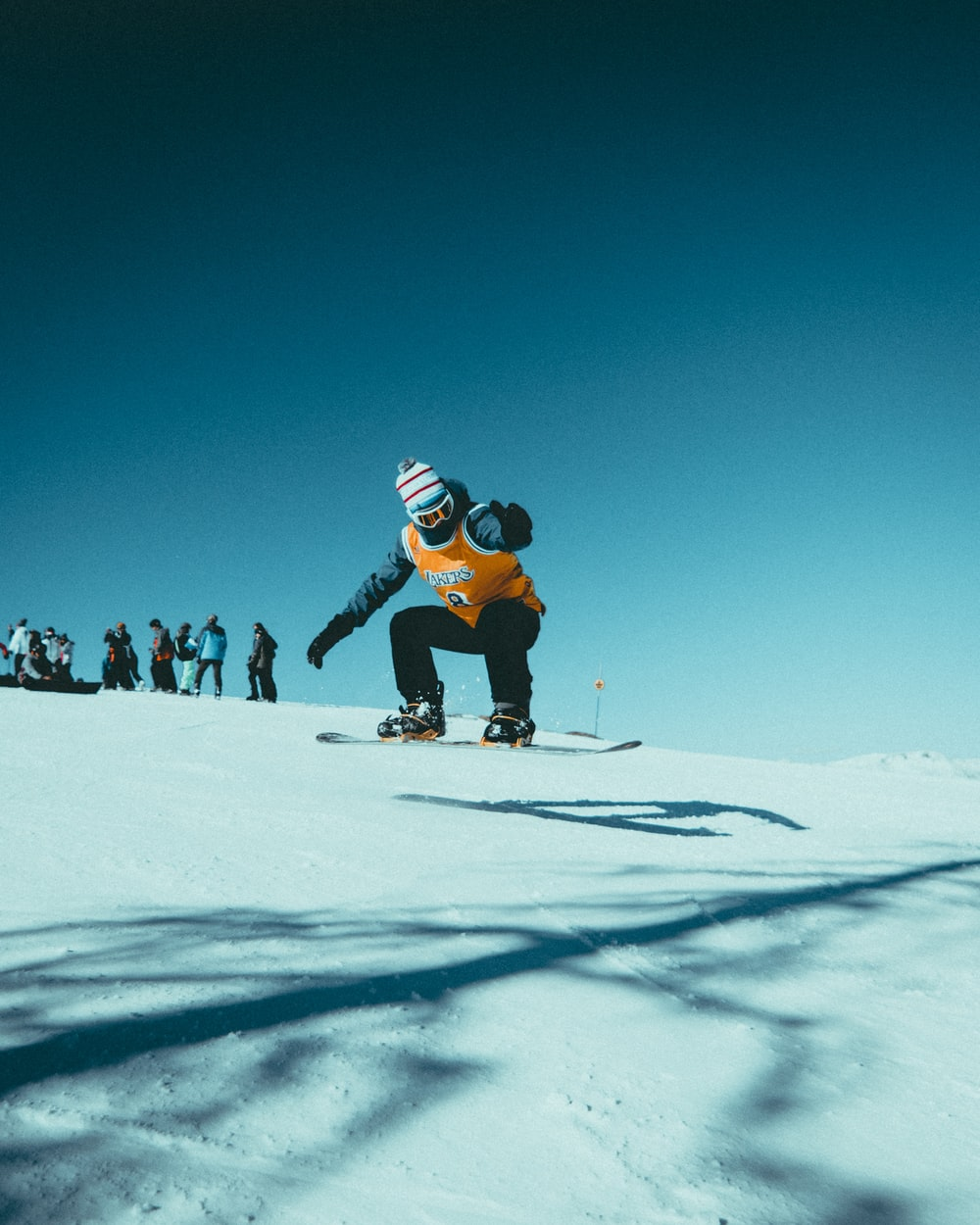 man skiing on snowy field during daytime