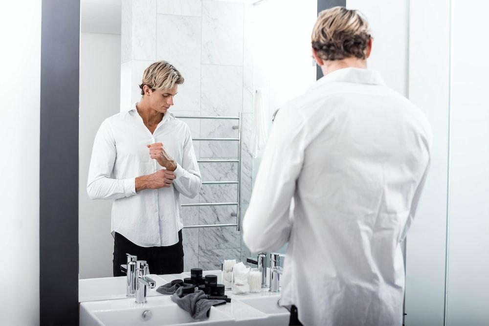 man wearing white dress shirt