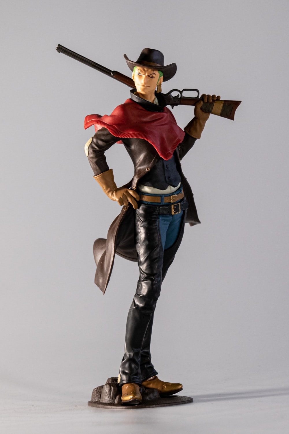 cowboy man with rifle action figure