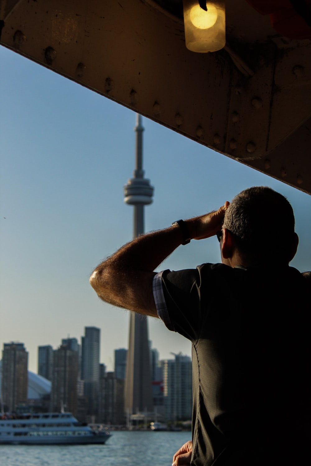 man standing in front of CN tower