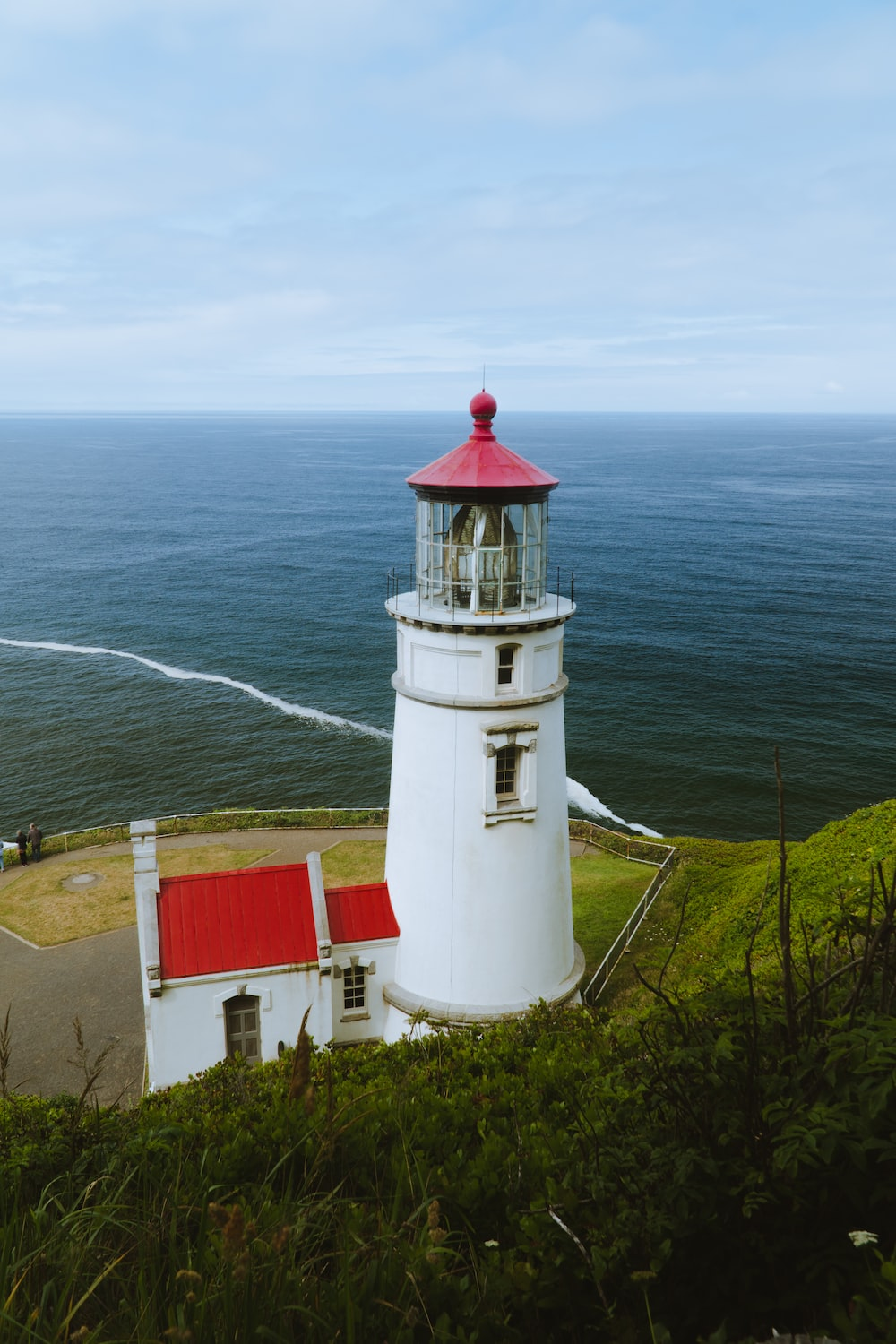 lighthouse on shore at daytime