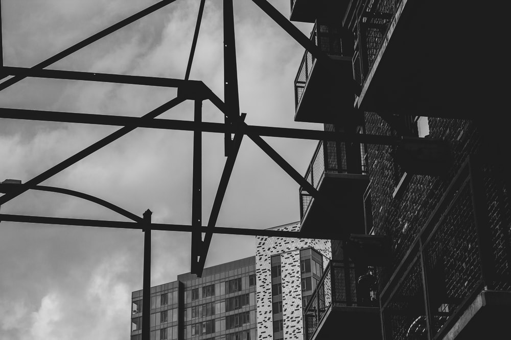 grayscale photo of gray and black scaffolding