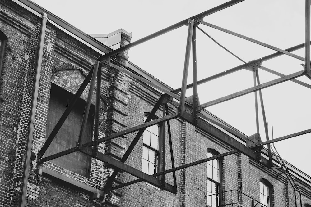 grayscale photography of gray and white concrete building