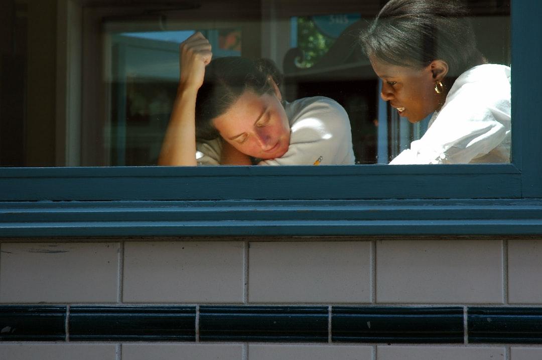 Student and teacher, working on a lesson, Starbucks window, Fremont, Seattle, Washington, USA