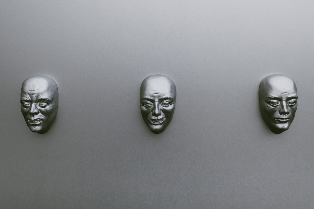 three silver-colored masks