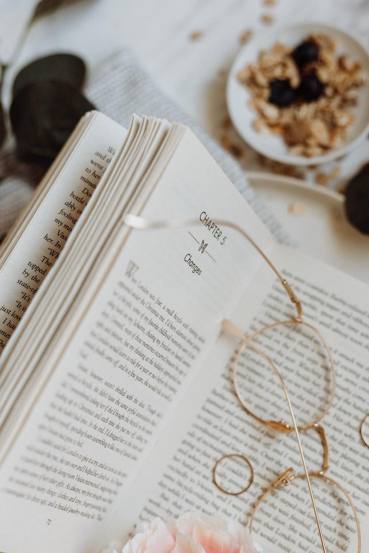eyeglasses on opened book