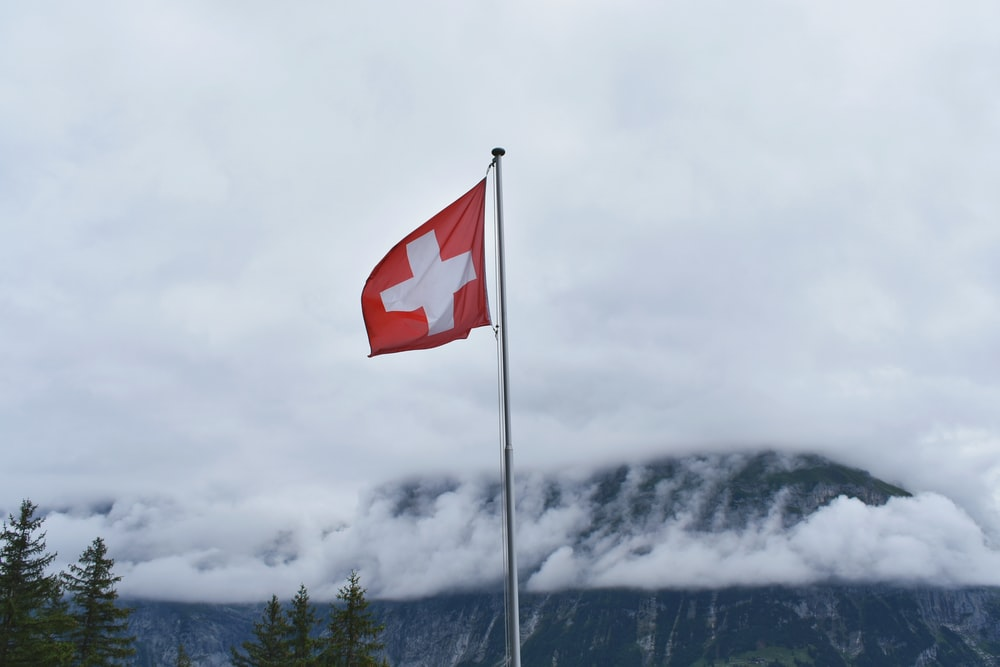 Switzerland flag during cloudy day