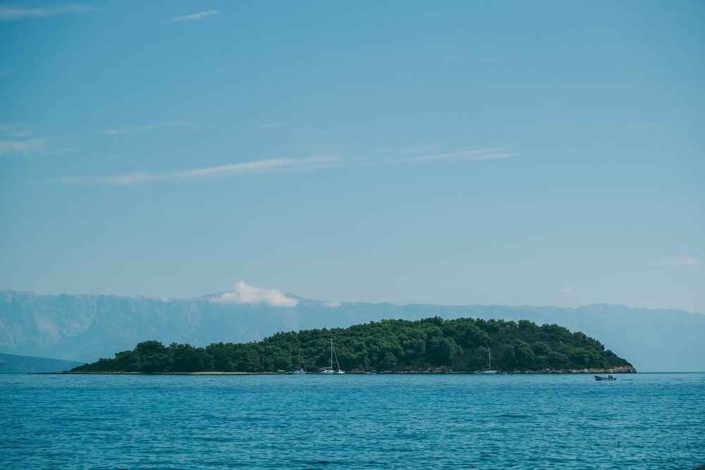 island under clear sky at daytime