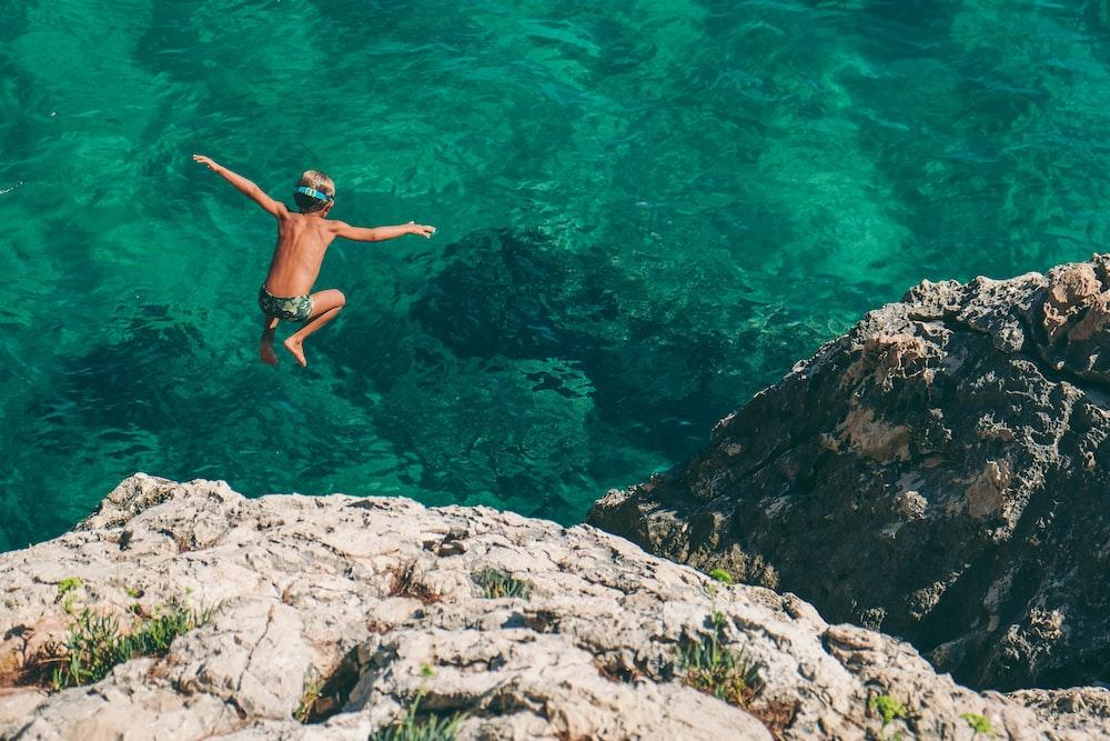 boy diving on sea