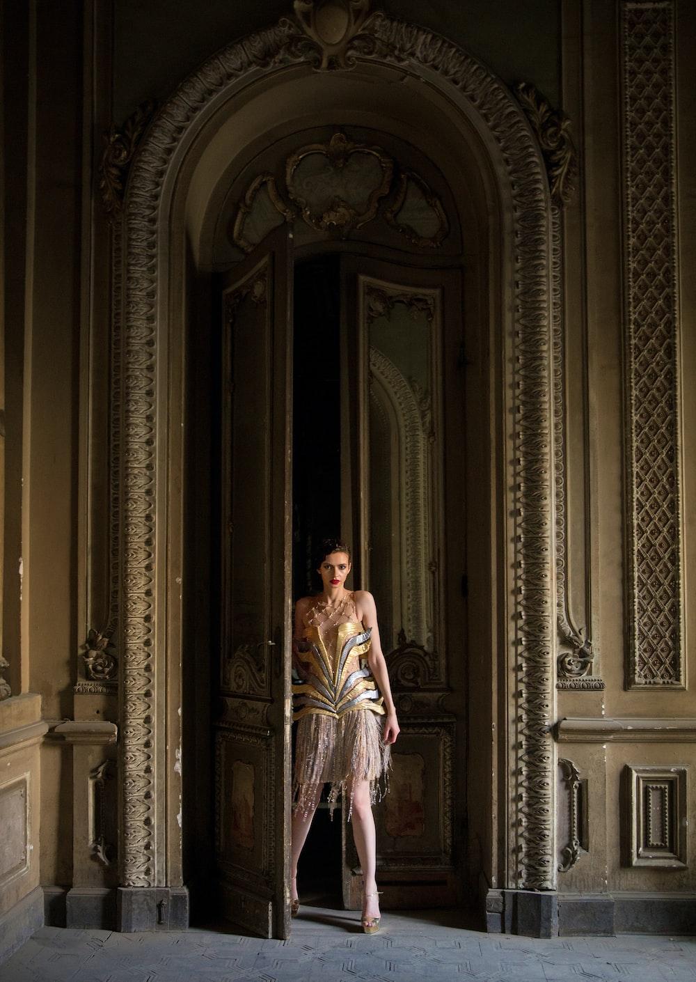 woman standing beside opened door