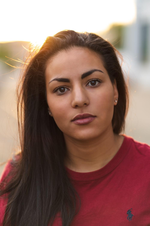 woman wearing red Polo Ralph Lauren crew-neck shirt