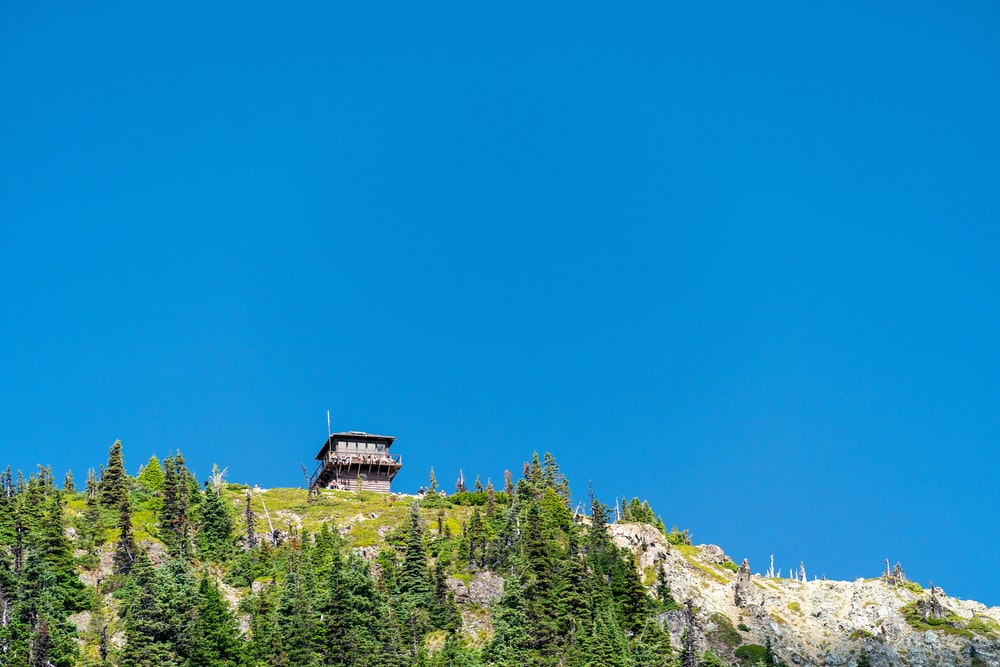 building on top of a mountain under blue sky during daytime