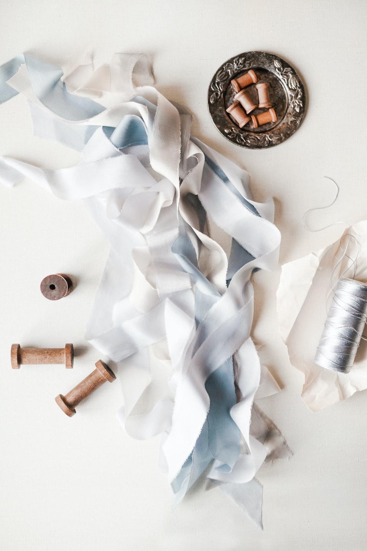 white thread near white fabrics