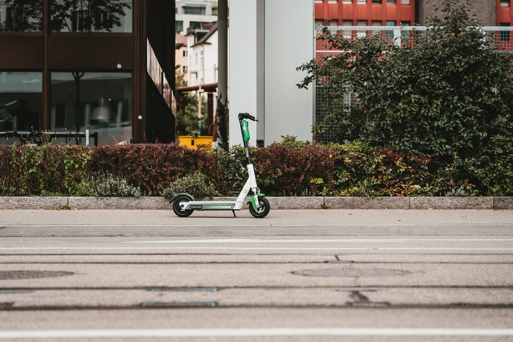 white and green kick scooter