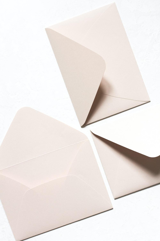 three white mail envelops