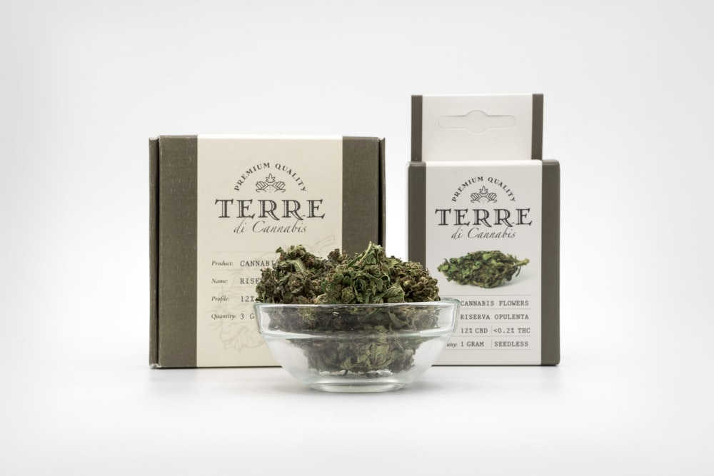 Terre cannabis in bowl by boxes