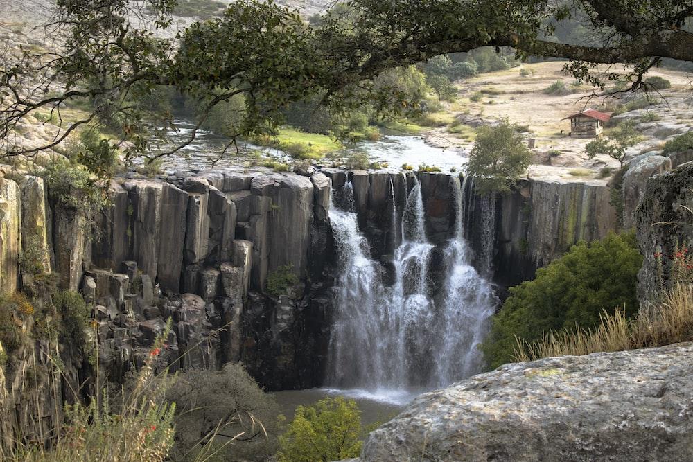 waterfalls between cliff