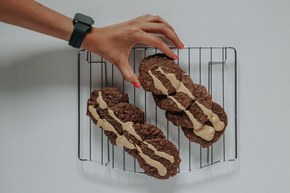 chocolate cookies on wire tray