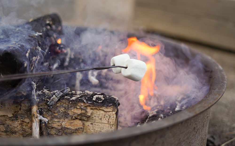 white marshmallow grilled on fire