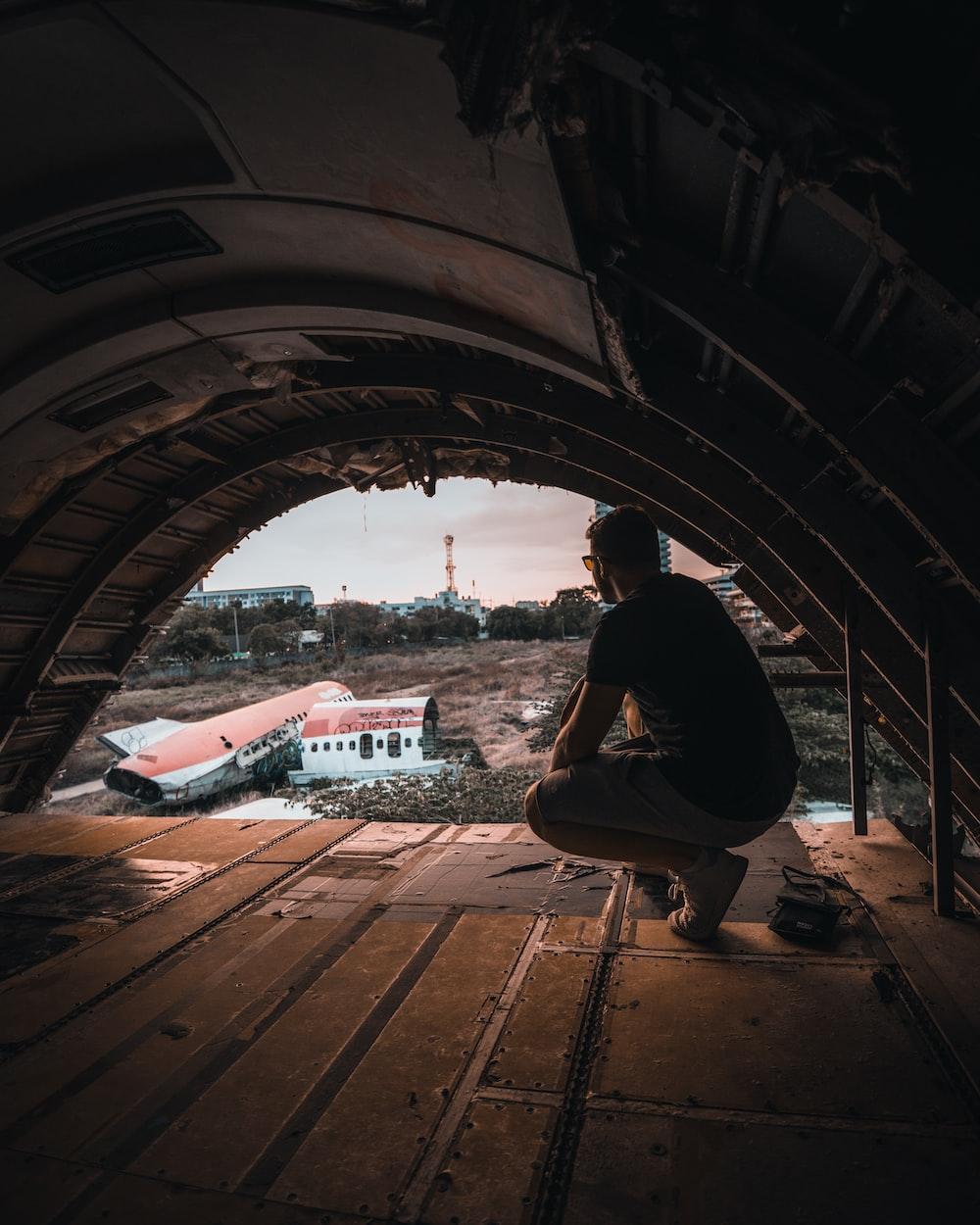 man under arch tunnel