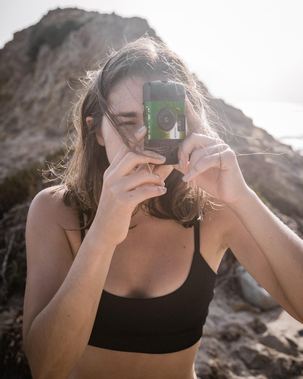 woman takes photo