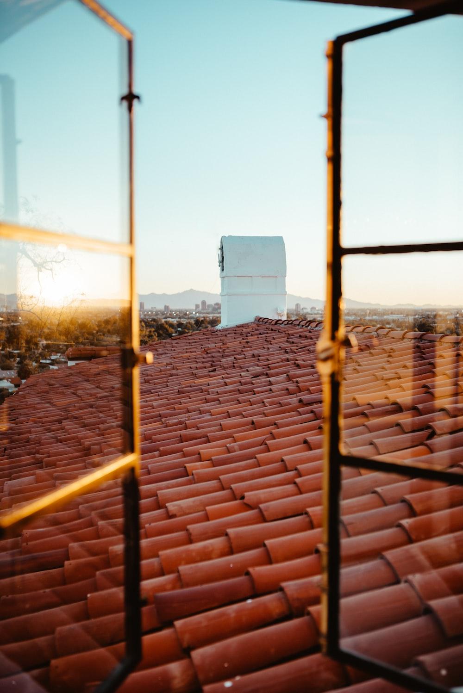 orange roof shingles during daytime