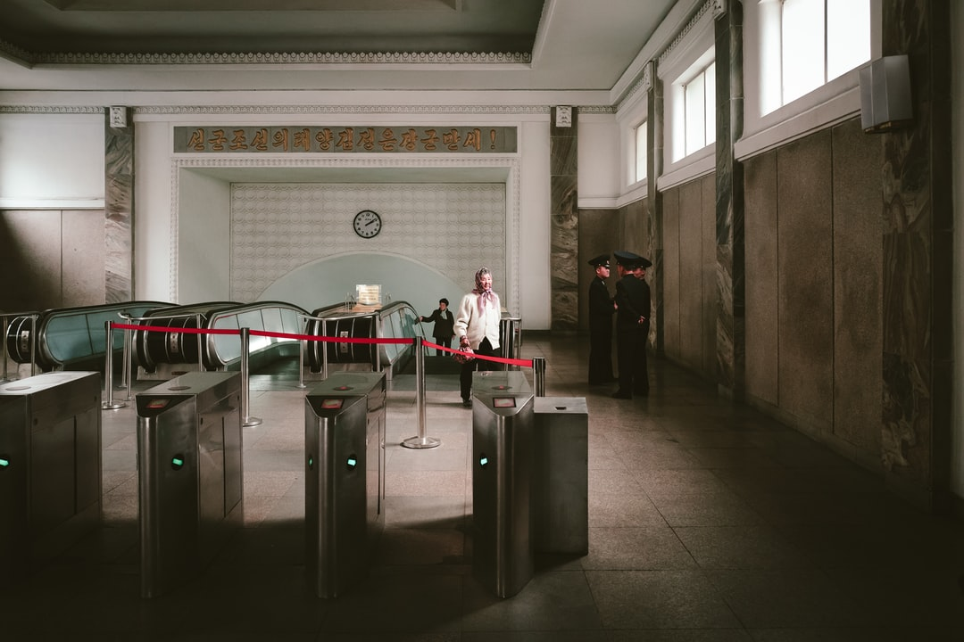 North Korea, subway, architecture, soldiers, old lady