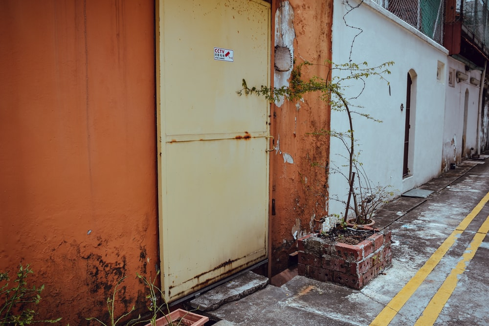 white and orange building sowing closed door