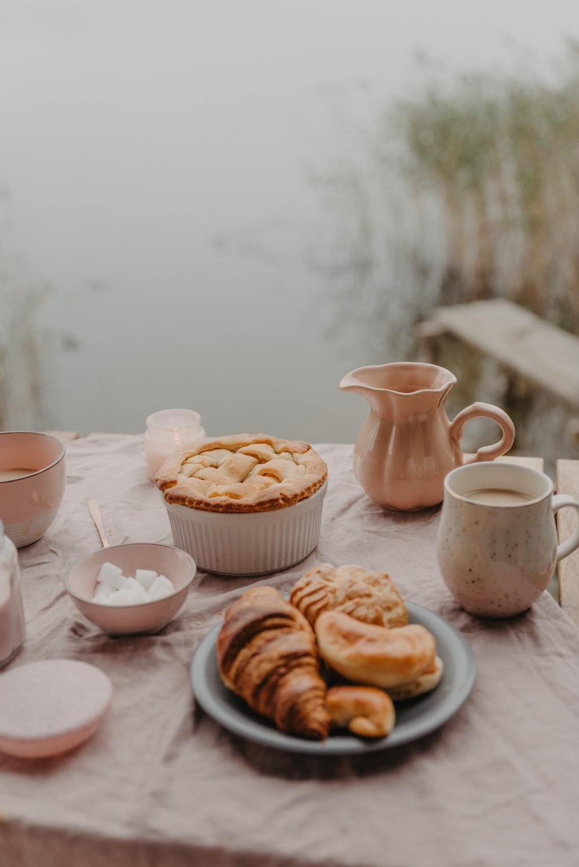 selective focus photography of breads beside mug