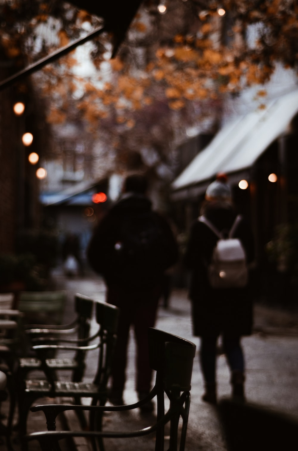 shallow focus photography unknown persons walking outdoors