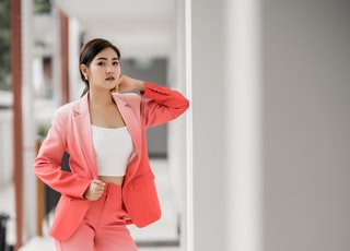 woman in white top and red 2-piece suit