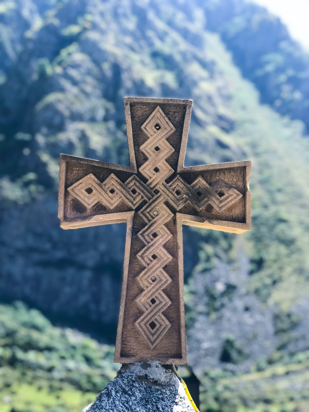 closeup photo of gray cross decor