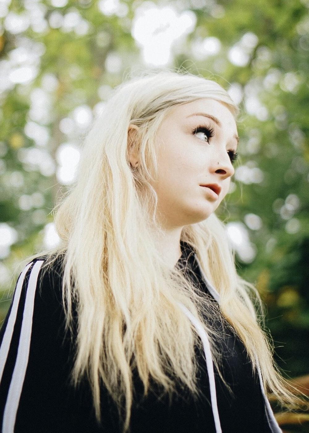 woman with blonde hair wearing black jacket