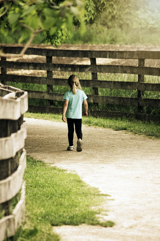 girl walking on walkway