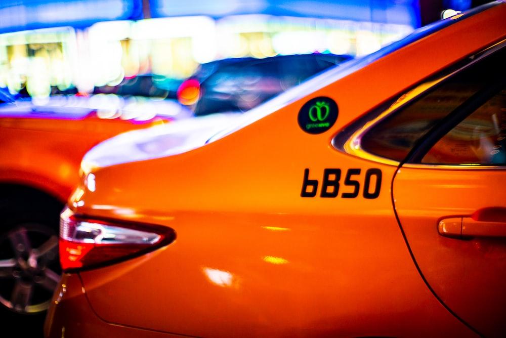 panning photo of orange car