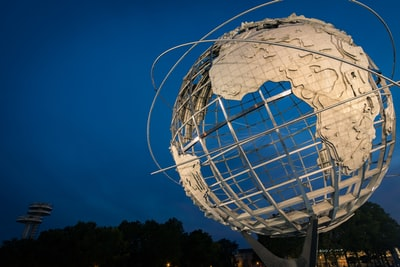 low angle photo of earth metal statue globe zoom background