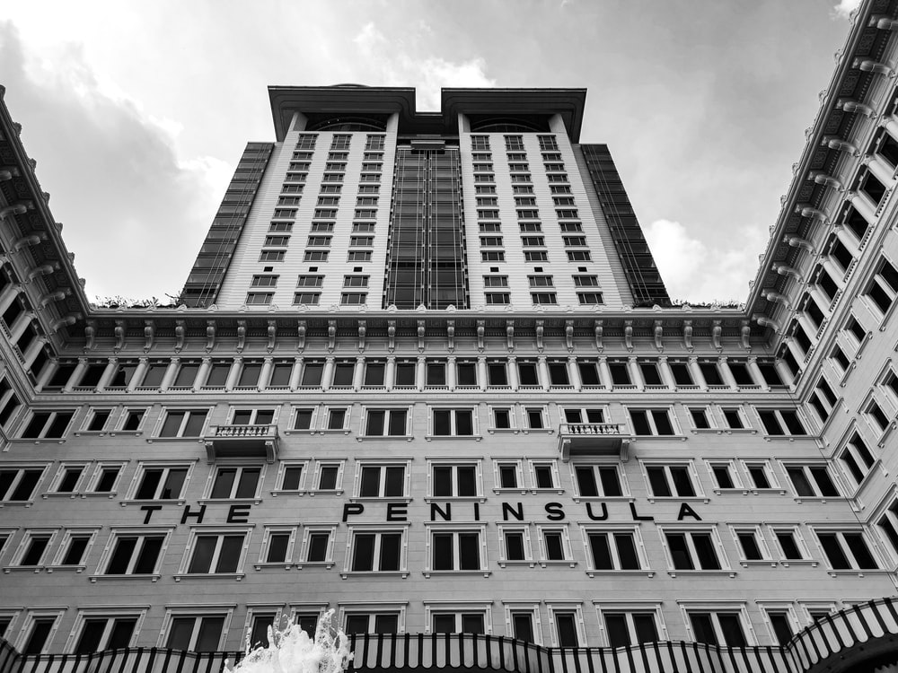 grayscale photography of The Peninsula building