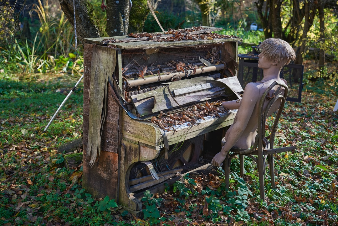 Derelict scene of a piano played by a broken manequin. I came across this setting when walking in the middle of nowhere near the city of Vallorbe, Switzerland.
