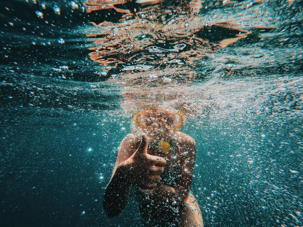 boy wearing goggles underwater