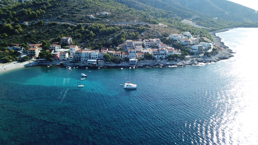 aerial photography of ocean near houses